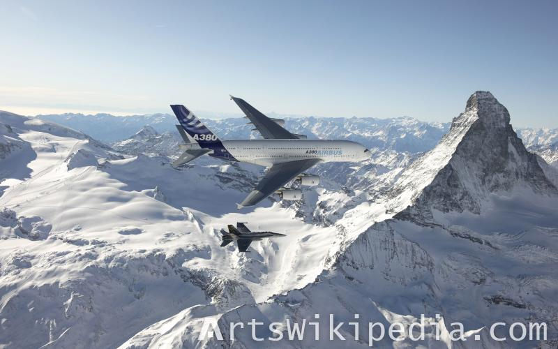 Air Bus and Jet above Snow Mountain