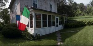 usa-and-italy-flag-on-old-house-5908e75e7ac6c