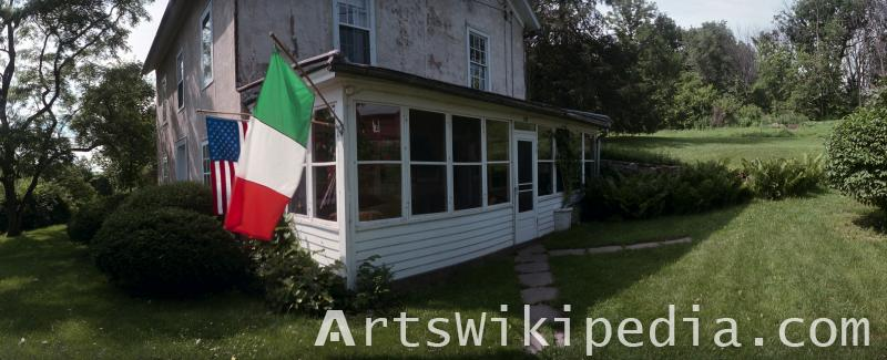 USA and Italy flag on old house