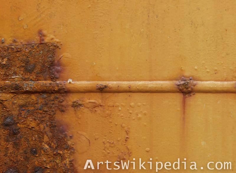 Rusted old painted metal wall