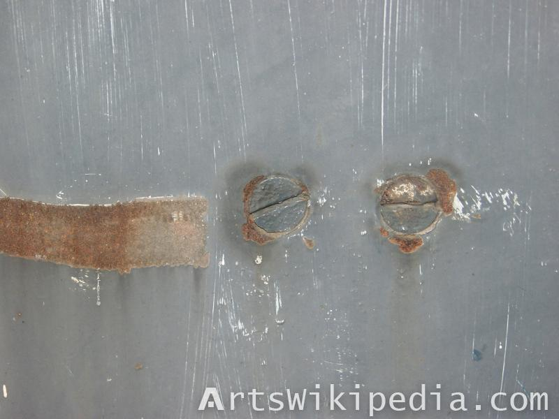 bolts on scratched metal