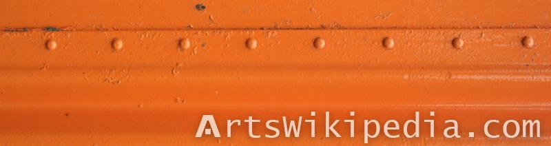 orange painted metal with studs