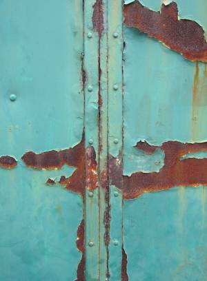 blue-painted-rusty-metal-studded