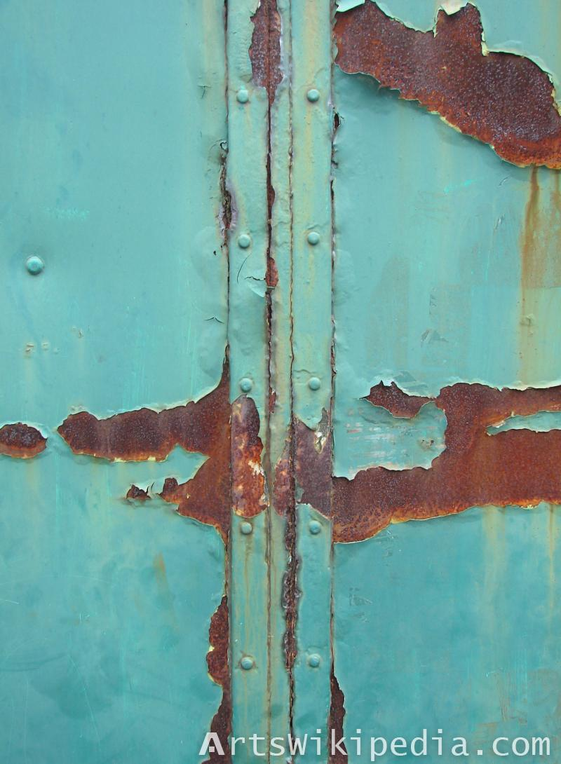 blue painted rusty metal studded