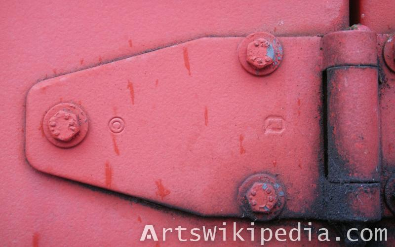 red painted metal joint