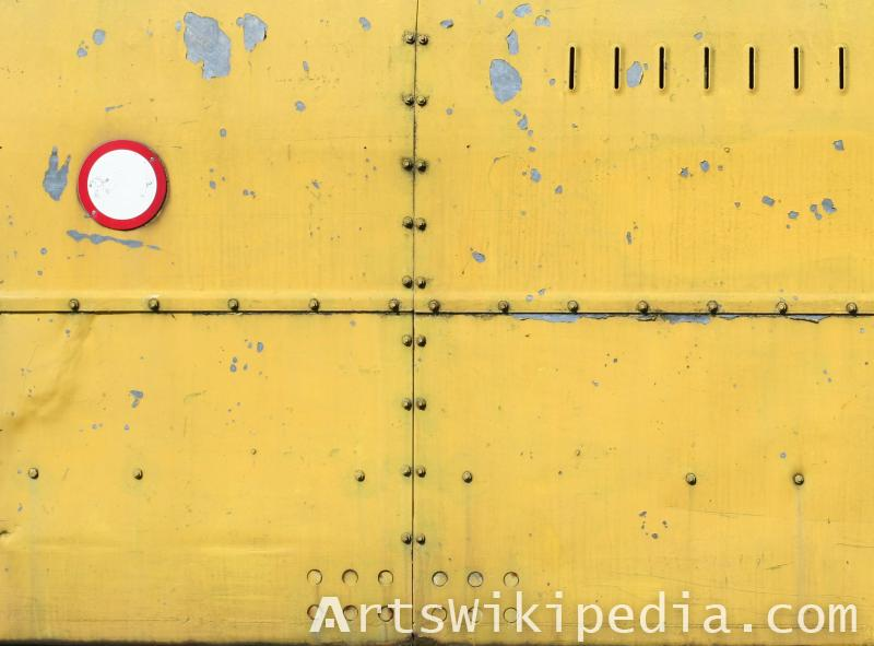 yellow painted bolted metal wall