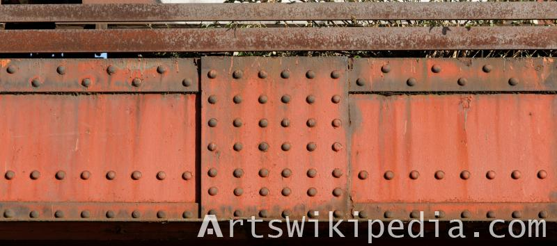 red painted bridge studded joint