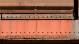red-painted-steel-bridge