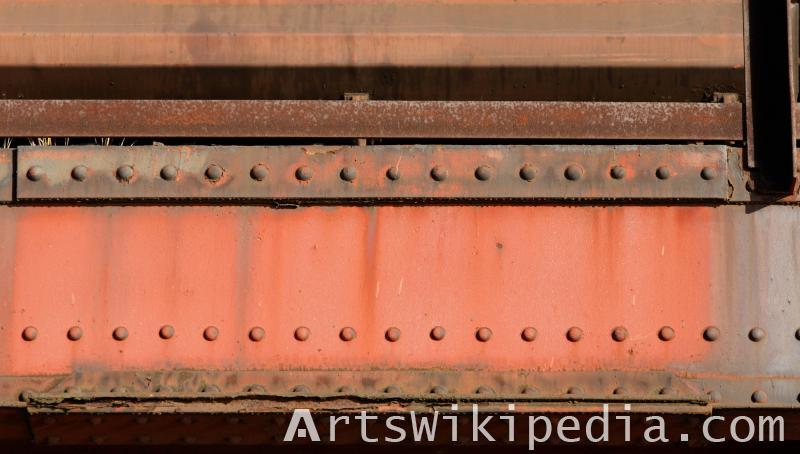 red painted steel bridge