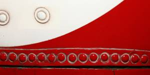 red-and-white-bolted-metal