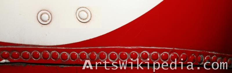 red and white bolted metal