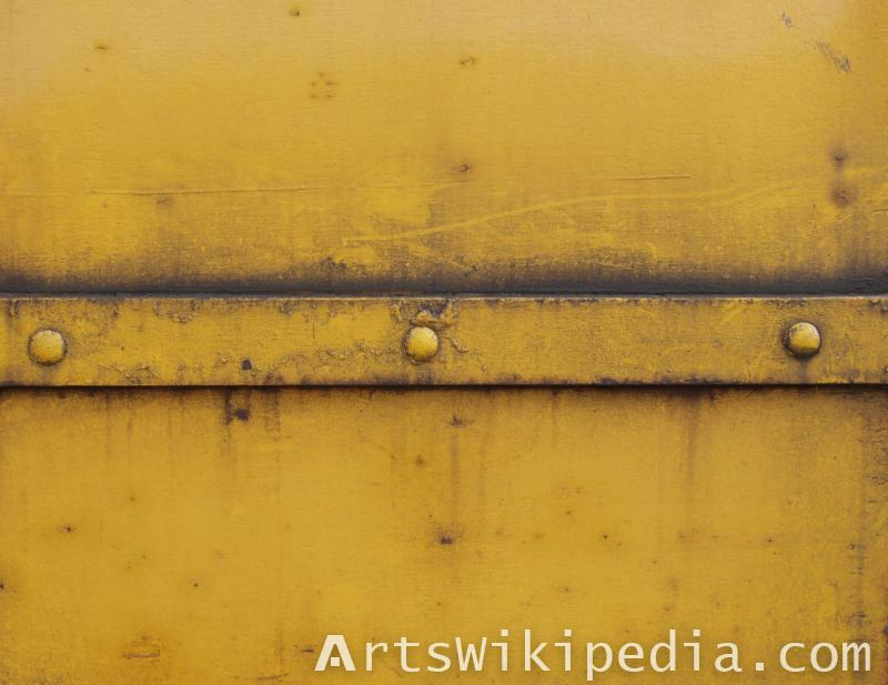 dirty yellow painted metal