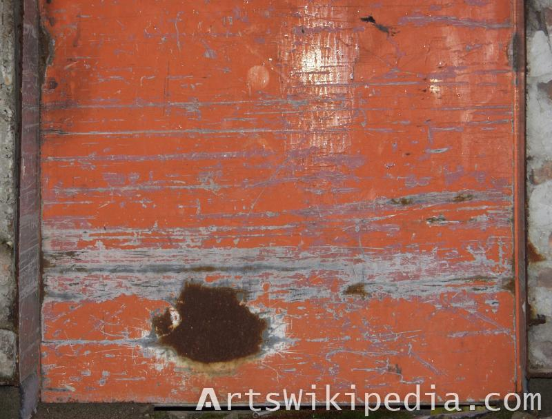 red painted metal scratch